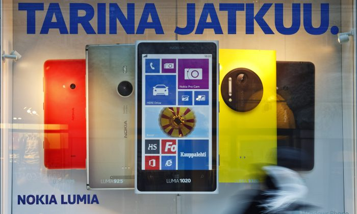 """An advertisement in a flagship store of Finnish telecom manufacturer Nokia reads """"the story goes on,"""" in Helsinki, Finland, on Jan. 23, 2014. (Roni Rekomaa/AFP/Getty Images)"""
