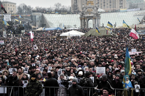 People gather for a rally against Russian intervention in Ukraine on central Kyiv's Independence square on March 2, 2014. Ukraine said on March 2 that it would call up all military reservists after President Vladimir Putin's threat to invade Russia's neighbour drew a blunt response from President Barack Obama. (Louisa Gouliamakai/AFP/Getty Images)