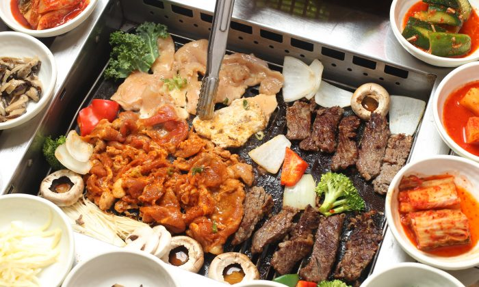 Korean barbecue, with an assortment of side dishes, or banchan. (Epoch Times)