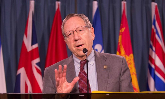Liberal MP Irwin Cotler is looking for cooperation from the Conservative government to pass a private member's bill that aims to draw attention to the plight of political prisoners. Cotler announced the bill on Parliament Hill on Feb. 28, 2014. (Matthew Little/Epoch Times)