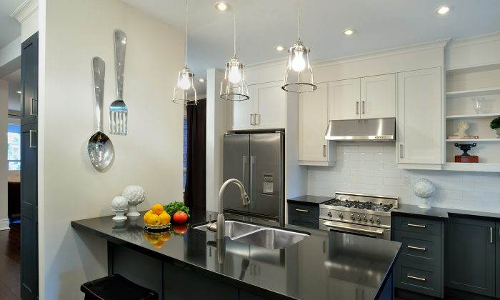 Steel grey lower cabinets in this kitchen co-ordinate well with the stainless steel appliances. (Larry Arnal)
