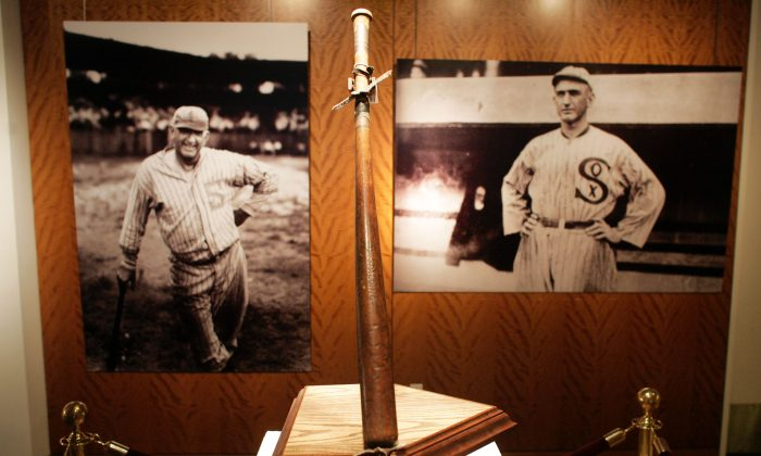'Shoeless' Joe Jackson's bat stands on display during an auction preview at Sotheby's December 5, 2005 in New York City. The bat, called 'Black Betsy,' will be auctioned December 10 and was last purchased at a 2001 auction for $577,610. (Michael Nagle/Getty Images)