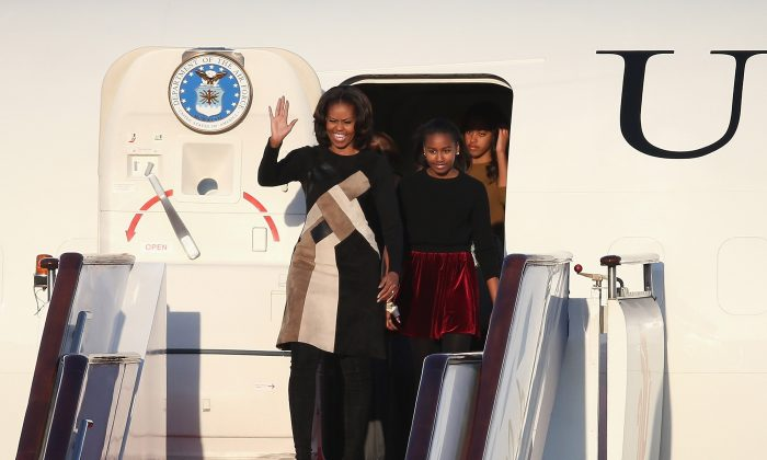 First Lady Michelle Obama (L) with her daughters Sasha Obama (C) and Malia Obama (R) arrives at Beijing Capital International Airport on March 20, 2014 in Beijing, China. The six-day tour will focus on culture and education, not politics. (Feng Li/Getty Images)