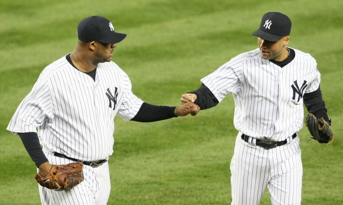 The Yankees are going to need vintage performances from CC Sabathia (L) and Derek Jeter if they are going to return to greatness in 2014. (Nick Laham/Getty Images)