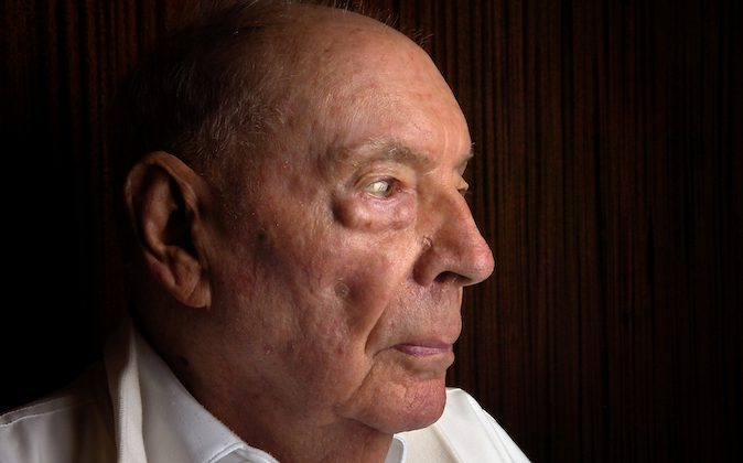 In this Aug. 27, 2009 file photo, John E. Love, who is a Bataan Death March survivor, poses for a portrait in Albuquerque, N.M.   An Albuquerque retirement home says Love, a Bataan Death March survivor who led a campaign to change the caption on a historic march photo from The Associated Press, has died. Gerry Lightwine, pastor at La Vida Llena, says Love died Monday, March 17, 2014 after a long battle with cancer. He was 91. Love was one of 75,000 Filipino and American soldiers who were taken captive by the Japanese in World War II when the U.S. forces surrendered in the province of Bataan and Corregidor Island in April 1942. Love later worked to change the caption on one of the most famous photos in AP's library about the march. The photo, thought to be of the Bataan Death March, actually was an Allied POW burial detail. The AP corrected the caption in 2010, 65 years after the image was first published. (AP Photo/The Albuquerque Journal, Pat Vasquez-Cunningham)