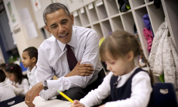 President Barack Obama sits with Emily Hare at Powell Elementary School in Washington, D.C., Tuesday. Obama visited the school to talk about his 2015 budget proposal. (AP Photo/Pablo Martinez Monsivais)