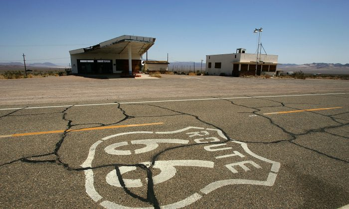 A symbol based on the original Route 66 road signs is seen painted on the highway in Ludlow, Calif., in June 2007. (David McNew/Getty Images)