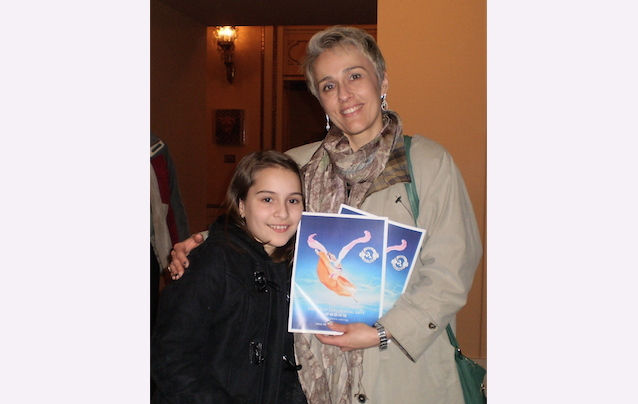 Dora Matache and her daughter enjoy Shen Yun Performing Arts at the Orpheum Theater, on March 9. (Epoch Times)