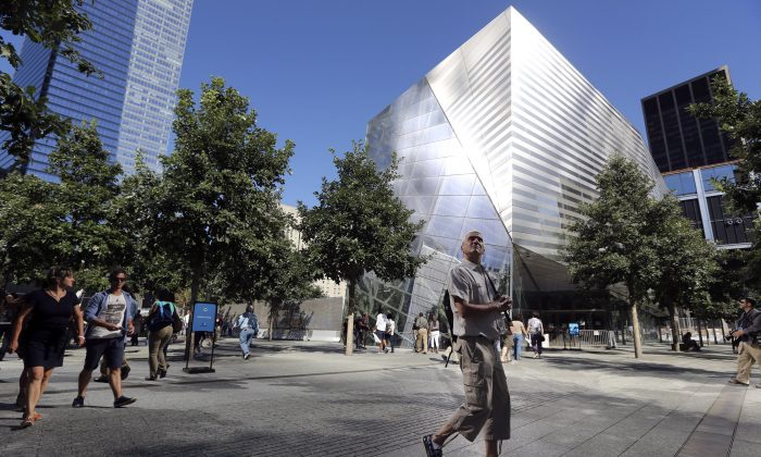 A visitor to the National September 11 Memorial and Museum takes in the sight as he walks past the museum in Lower Manhattan Sept. 6, 2013. (Mary Altaffer/AP)