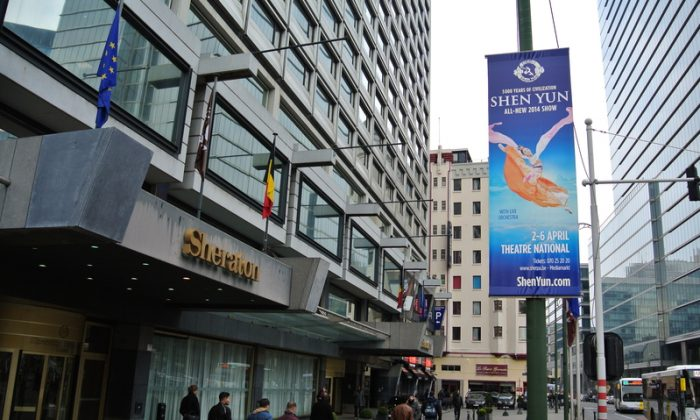 A poster for Shen Yun Performing Arts is posted in front of a Sheraton hotel in Brussels, Belgium. Chinese Communist Party leader Xi Jinping is scheduled to stay at the hotel, and the Chinese consulate has asked for the posters to be removed. (Xiaoran / The Epoch Times)