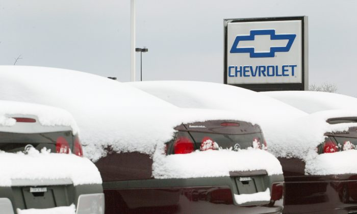 New Chevrolet cars are buried in snow at Bredemann Chevrolet in Park Ridge, Illinois. (Tim Boyle/Getty Images)