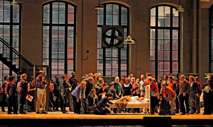"""Diana Damrau (in bed) sings the title role in a revival of Bellini's """"La Sonnambula."""" (Ken Howard/Metropolitan Opera)"""