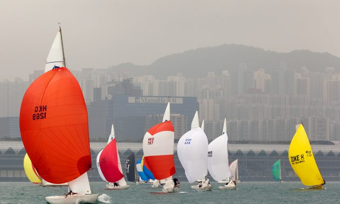 A view of a smog enshrouded Hong Kong and Victoria Harbour during the Royal Hong Kong Yacht Club Tomes Cup persuit race on Saturday Mar 1, 2014. The Tomes Cup is the third race in the four-race Top Dog Trophy. (RHKYC/Guy Nowell)