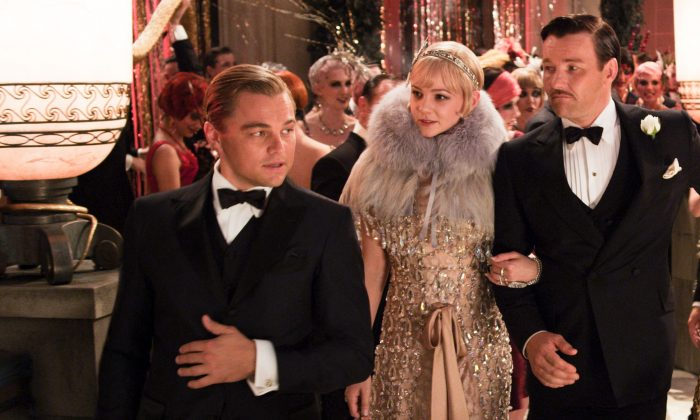 """From left, Leonardo DiCaprio as Jay Gatsby, Carey Mulligan, as Daisy Buchanan and Joel Edgerton as Tom Buchanan in """"The Great Gatsby."""" Undated publicity photo. (AP Photo/Warner Bros. Pictures)"""