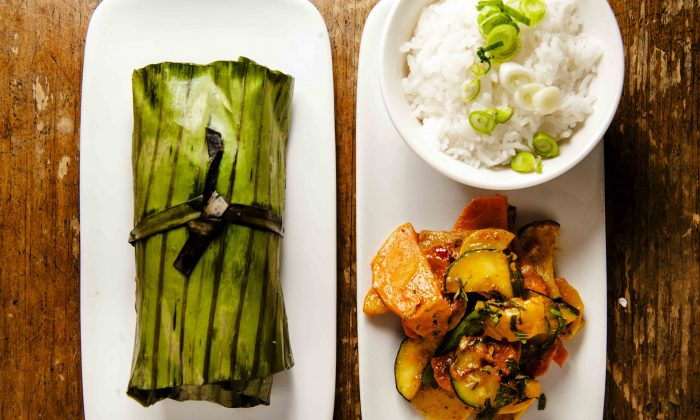 Pumpkin stuffed tilapia in banana leaf, coconut, and red curry vegetables. (Courtesy of Rodin Banica)