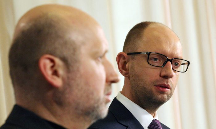 Ukrainian Prime Minister Arseniy Yatsenyuk (R) speaks to the media, flanked by Olexandr Turchynov, speaker of the Parliament and interim Ukrainian president, after closing a session of Parliament in Kyiv, March 2, 2014. (Anatolii Stepanov/AFP/Getty Images)