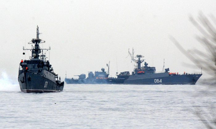 Russian Navy ships are docked in the Sevastopol bay on March 4. Russian forces have surrounded Ukrainian military bases across Crimea as the Russian-speaking autonomous region has been thrown into turmoil following the ouster last month of Moscow-backed president Viktor Yanukovych. Ukrainian officials said on March 3 that Russia had given Ukrainian soldiers in Crimea an ultimatum to surrender or face an all-out assault, although Russia denounced the claim as 'complete nonsense'.  (Viktor Drachev/AFP/Getty Images)