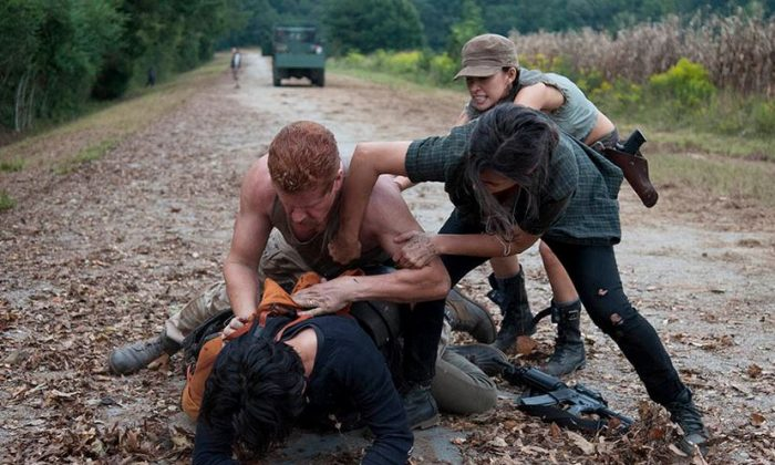 Abraham fights with Glenn while Tara and Rosita try to break them up. (Gene Page/AMC)