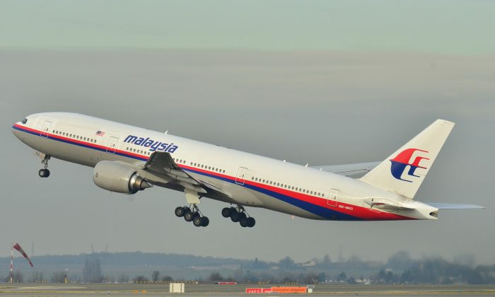 The Malaysia Airlines Boeing 777-200ER that disappeared from air traffic control screens on March 8, 2014, taking off from Roissy-Charles de Gaulle Airport in France, on Dec. 26, 2011. (Laurent Errera/AP Photo)
