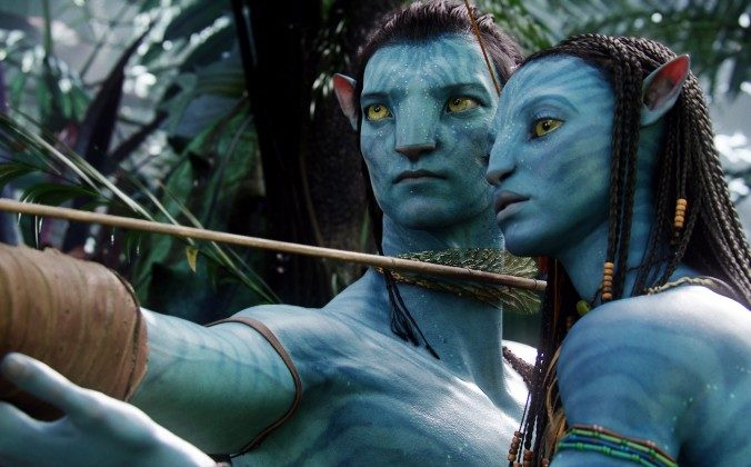 """In this undated file film publicity image originally released by 20th Century Fox, the character Neytiri, voiced by Zoe Saldana, right, and the character Jake, voiced by Sam Worthington are shown in a scene from, """"Avatar."""" Director James Cameron says he plans to make three sequels to his 2009 sci-fi blockbuster movie """"Avatar"""" in New Zealand. (AP Photo/20th Century Fox, File)"""