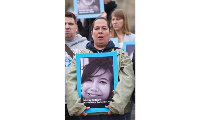Supporters of Sisters in Spirit, a group that works to raise awareness about the high rate of aboriginal women who have been murdered or gone missing in Canada, protested on Parliament Hill on Oct. 4, 2011. The group is among many calling for action on issue. (Matthew Little/The Epoch Times)