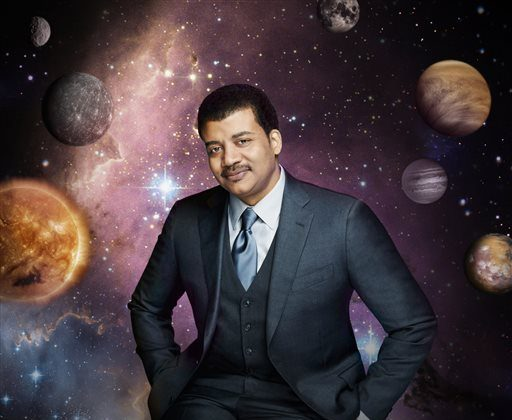 """This photo released by Fox shows Neil deGrasse Tyson, the astrophysicist who hosts the television show, """"Cosmos: A Spacetime Odyssey,"""" premiering Sunday, March 9, 2014, 9:00-10:00 PM ET/PT on Fox and simultaneously across multiple U.S. Fox networks. The series will explore how we discovered the laws of nature and found our coordinates in space and time. (AP Photo/Fox, Patrick Eccelsine)"""