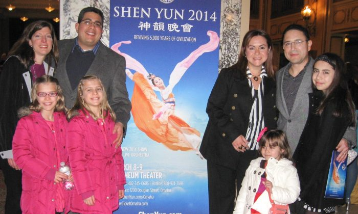 Doctors Diego Torres, Douglas Inciard, and their families attended Shen Yun Performing Arts, at Omaha's Orpheum Theater, on March 8. (Cat Howland/Epoch Times)