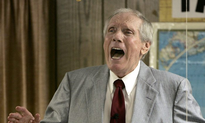 FILE - In this March 19, 2006 file photo, the Rev. Fred Phelps Sr. preaches at his Westboro Baptist Church in Topeka, Kan. (AP Photo/Charlie Riedel, File)