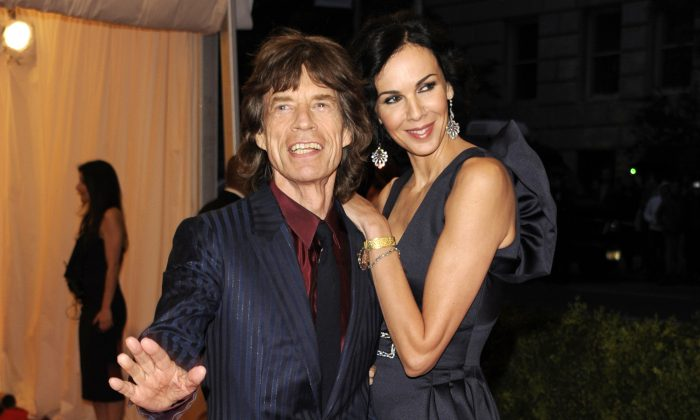 Singer Mick Jagger, left, and L'Wren Scott at the Metropolitan Museum of Art Costume Institute gala benefit, New York, May 7, 2012. Scott, a fashion designer, was found dead Monday, March 17, 2014, in Manhattan of a possible suicide. (AP Photo/Evan Agostini, File)