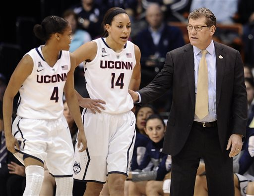Connecticut head coach Geno Auriemma, right, speaks with Moriah Jefferson, left, and Bria Hartley, center, during the first half of an NCAA college basketball game against Rutgers in the semifinals of the American Athletic Conference women's tournament, Sunday, March 9, 2014, in Uncasville, Conn. Connecticut is one of the No. 1 seeds in the NCAA tournament. (AP Photo/Jessica Hill)