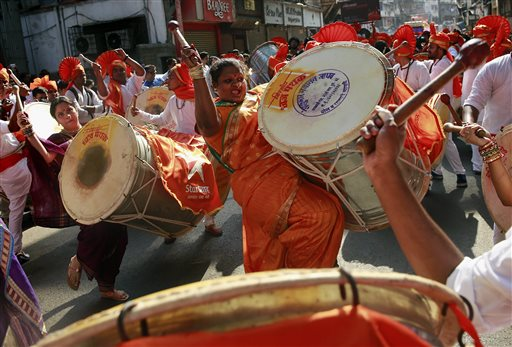 """People dressed in traditional attire take out a procession to celebrate """"Gudi Padwa"""", or the Marathi new year, in Mumbai, India, Monday, March 31, 2014. (AP Photo/Rafiq Maqbool)"""