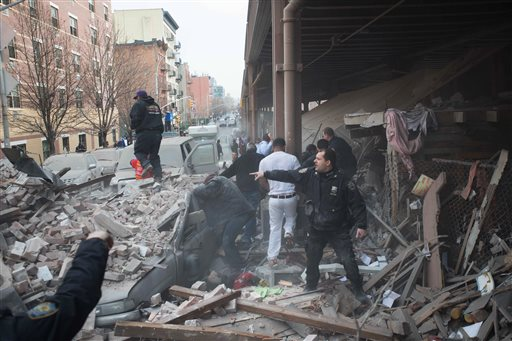 Police respond to the scene of an explosion that leveled two apartment buildings in the East Harlem neighborhood of New York, Wednesday, March 12, 2014. Con Edison spokesman Bob McGee says a resident from a building adjacent to the two that collapsed reported that he smelled gas inside his apartment, but thought the odor could be coming from outside. (AP Photo/Jeremy Sailing)