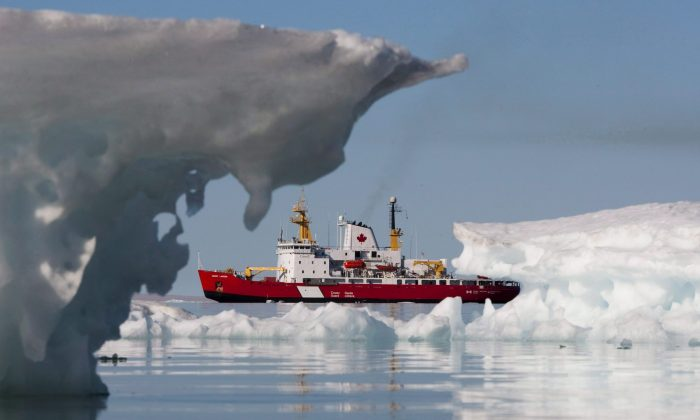 The Canadian Coast guard's icebreaker Henry Larsen is seen in Allen Bay, Nunavut, Aug. 25, 2010. Transport Minister Lisa Raitt plays down expectations that the Arctic is on the cusp of becoming an international shipping hub because of climate change. (The Canadian Press/Sean Kilpatrick)