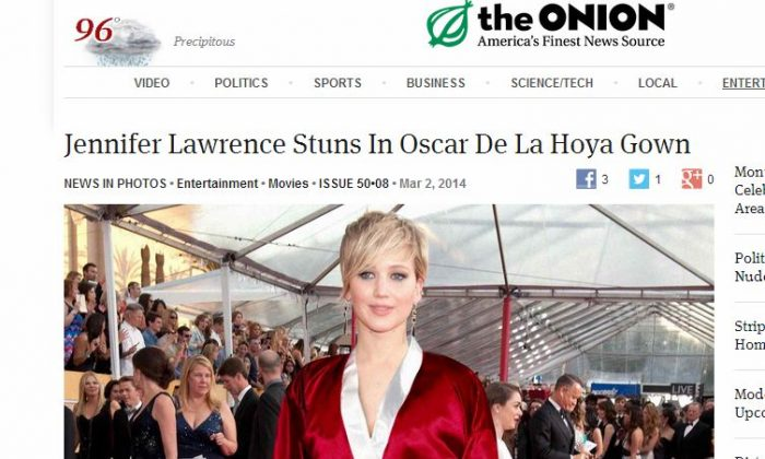 "Jennifer Lawrence did not wear a Oscar De La Hoya ""gown""--or boxing robe--at the Academy Awards show or on the red carpet on Sunday, as it was satire from The Onion.  (The Onion screenshot)"