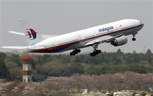 This photo taken in April, 2013, shows a Malaysia Airlines Boeing 777-200ER at Narita Airport in Narita, near Tokyo. A Malaysia Airlines Boeing 777-200 carrying 239 people lost contact with air traffic control early Saturday morning, March 8, 2014 on a flight from Kuala Lumpur to Beijing, and international aviation authorities still hadn't located the jetliner several hours later. (AP Photo/Kyodo News)