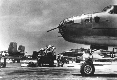 A Marine flight crew arrives to board a VMB-611 North American PBJ medium bomber, which assisted the combined American and Filipino forces in World War II. (Department of Defense)