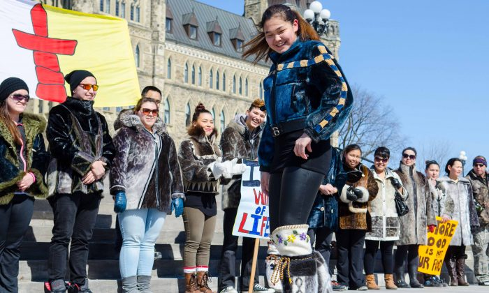 An Inuit student from Nunavut shows off a seal skin jacket and boots during a fashion show/protest on Parliament Hill, March 18, 2014. (Matthew Little/Epoch Times)