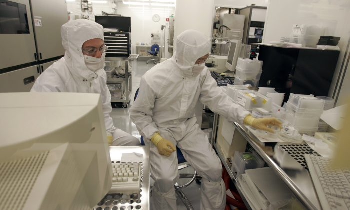 File photo shows Hewlett Packard technicians working on nanotechnology research in a clean room at HP headquarters in Palo Alto, Calif. University of Alberta researchers have developed a new sensory chip smaller than the width of a strand of hair that has the potential for use in a wide range of applications. (AP Photo/Paul Sakuma)