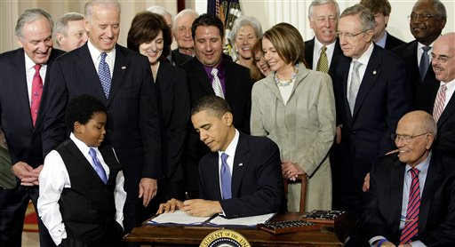 In this March 23, 2010 file photo, President Barack Obama signs the Affordable Care Act in the East Room of the White House in Washington. (AP Photo/J. Scott Applewhite, File)
