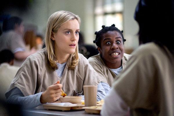 "A scene from ""Orange Is the New Black,"" with Piper (Taylor Schilling), left, and Suzanna ""Crazy Eyes"" Warren. (Uzo Aduba). (Paul Schiraldi/Netflix)"