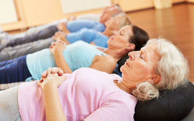 A file photo of people laying together with their eyes closed. (Shutterstock*)
