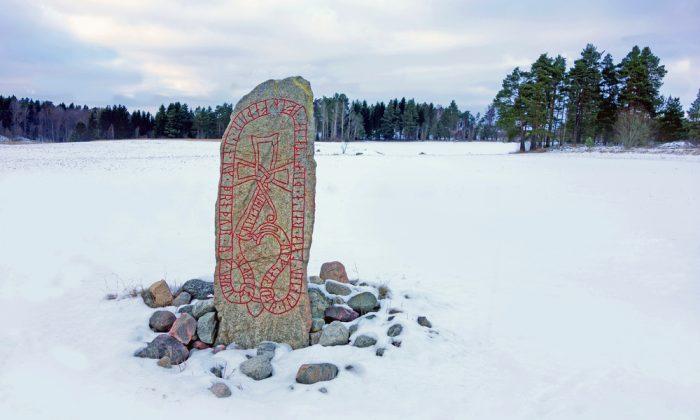 A picture of a runestone standing in a winter landscape. (*Shutterstock)