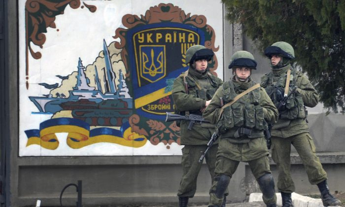 Russian forces block access to the base of the 36th detached brigade of the Ukrainian Navy's coastal guards, not far from the village of Perevalne, near Crimea, on March 5, 2014. (Alexander Nemenov/AFP/Getty Images)