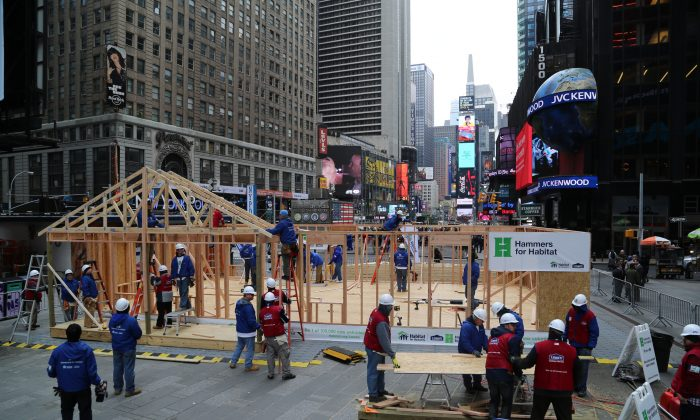 Habitat for Humanity and Lowe's volunteers build a home for a Sandy victim on March 20, 2014 in Times Square, NYC. (Courtesy of Habitat for Humanity)