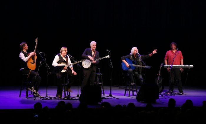Steve Martin joins Arlo Guthrie in celebrating a Woody Guthrie Award that was posthumously awarded to Pete Seeger (Courtesy of Grammy Museum.com; WireImage.com/ Cindy Ord)