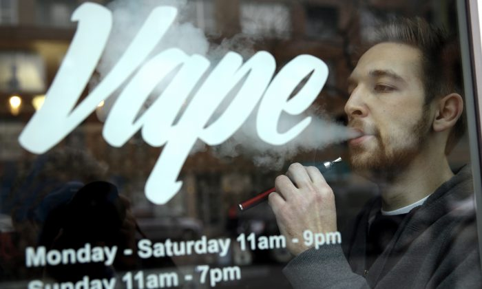 A man with an e-cigarette at Vape store in Chicago, on April 23, 2014. (Nam Y. Huh/AP Photo)