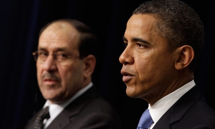 Iraqi Prime Minister Nouri Al-Maliki (L) and U.S. President Barack Obama hold a news conference in the Eisenhower Executive Office Building next to the White House December 12, 2011 in Washington, DC. (Chip Somodevilla/Getty Images)