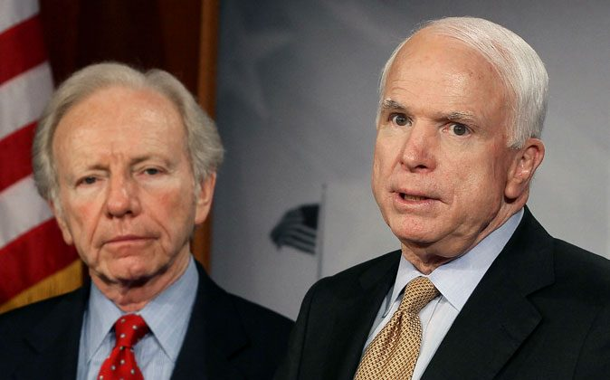 U.S. Sen. John McCain (R-AZ) (R) and U.S. Sen. Joseph Lieberman (I-CT) on Capitol Hill on March 28, 2012 in Washington, DC. (Mark Wilson/Getty Images)