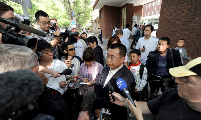 Foreign journalists interview Chinese rights lawyer Jiang Tianyong in Beijing on May 2, 2012. Jiang is currently detained by police in Jiansanjiang in Heilongjiang Province and is believed to be suffering torture. (Mark Ralston/AFP/Getty Images)