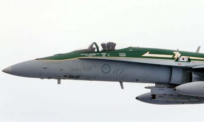A Royal Australian Air Force F/A-18 Hornet flys next to a KC-30A Multi Role Tanker Transport aircraft fuel line during the Australian Defence Force Air-To-Air refuelling on February 27, 2013 in Melbourne, Australia. The Australian Federal Government is planning to replace the ageing F/A-18 and already retired F-111 bomber with a fleet of 100 F-35 Lightning ll, at a cost of AUD$16 billion, with the first of the jets to be delivered to the Royal Australian Air Force at the end of 2014. (Michael Dodge/Getty Images)